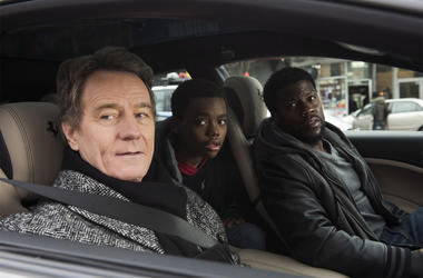 "This image released by STXfilms shows Bryan Cranston, from left, Jahi Di'Allo Winston, and Kevin Hart in a scene from ""The Upside."" (David Lee/STXfilms via AP)"
