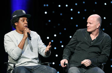 "Rapper and business mogul Shawn ""Jay-Z"" Carter, left, speaks as Michael Novogratz, founder and CEO Galaxy Digital, listens during the launch of a partnership among entertainment moguls, recording artists, business and sports leaders who hope to transform"