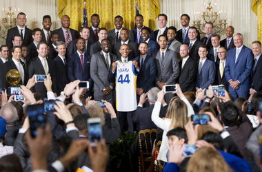 In this Feb. 4, 2016, file photo, President Barack Obama holds up Golden State Warrior basketball jersey given to him by team members during a ceremony in the East Room of the White House in Washington where he honored the 2015 NBA Champions. The Warriors