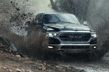 """This undated file photo provided by Ram Truck Brand shows a scene from the company's Super Bowl spot. Last year, a Ram truck ad showed people doing service-oriented tasks set against audio of King's speech, which urges people to be """"great"""" by serving the"""