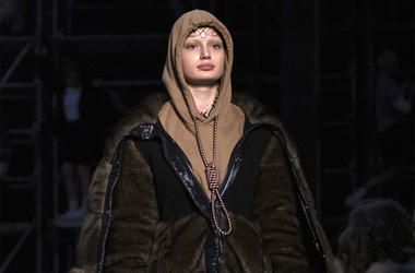 This Feb. 17, 2019 photo shows a model wearing a creation by Burberry at the Autumn/Winter 2019 fashion week runway show in London. The chief executive and chief creative officer of luxury powerhouse Burberry have apologized for putting a hoodie with stri