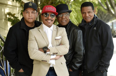 In this Tuesday, Feb. 26, 2019 photo, Marlon Jackson, second from left, Tito Jackson, second from right, and Jackie Jackson, far right, brothers of the late musical artist Michael Jackson, and Tito's son Taj, far left, pose together for a portrait outside