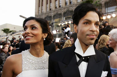 In this Feb. 27, 2005 file photo, singer Prince arrives with his wife Manuela Testolini for the 77th Academy Awards in Los Angeles.  (AP Photo/Kevork Djansezian, File)