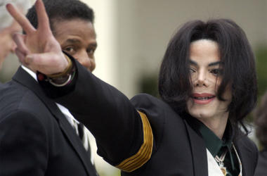 In this March 2, 2005, file photo, pop icon Michael Jackson waves to his supporters as he arrives for his child molestation trial at the Santa Barbara County Superior Court in Santa Maria, Calif. (AP Photo/Michael A. Mariant, File)