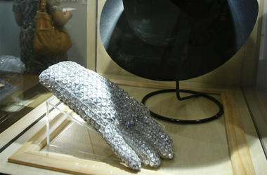 In this June 21, 2010 file photo, a hat and sequined glove once belonging to Michael Jackson is displayed at the Motown Historical Museum at Hitsville U.S.A. in Detroit. (AP Photo/Carlos Osorio)