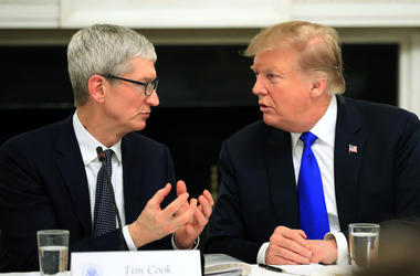 In this Wednesday, March 6, 2019 file photo, President Donald Trump talks to Apple Inc. CEO Tim Cook during the American Workforce Policy Advisory Board's first meeting in the State Dining Room of the White House in Washington. (AP Photo/Manuel Balce Cene