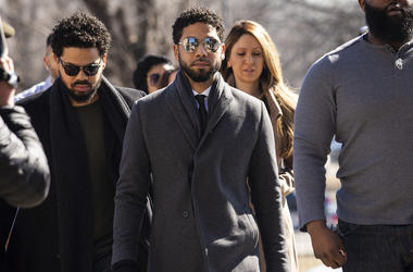 """Empire"" actor Jussie Smollett, center, arrives at Leighton Criminal Court Building for a hearing to discuss whether cameras will be allowed in the courtroom during his disorderly conduct case on Tuesday, March 12, 2019, in Chicago. (Ashlee Rezin/Chicago"
