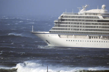 The cruise ship Viking Sky lays at anchor in heavy seas, after it sent out a Mayday signal because of engine failure in windy conditions, near Hustadvika, off the west coast of Norway, Saturday March 23, 2019. The Viking Sky is forced to evacuate its 1,30