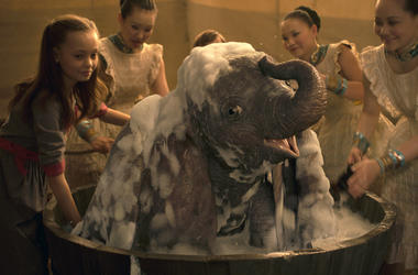 """This image released by Disney shows Nico Parker, left, in a scene from """"Dumbo."""" (Disney via AP)"""