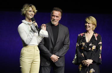 "Mackenzie Davis, left, a cast member in the upcoming film ""Terminator: Dark Fate,"" talks about the film as fellow cast members Arnold Schwarzenegger, center, and Linda Hamilton look on during the Paramount Pictures presentation at CinemaCon 2019, the offi"