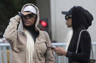 This July 11, 2018 file photo shows Shannade Clermont, left, and her twin sister Shannon outside of federal court in New York after her arraignment on charges she stole debit card information from a man who died from a drug overdose in his Manhattan apart