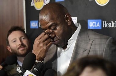 Magic Johnson wipes his eyes as he speaks to reporters prior to an NBA basketball game between the Los Angeles Lakers and the Portland Trail Blazers on Tuesday, April 9, 2019, in Los Angeles. (AP Photo/Mark J. Terrill)