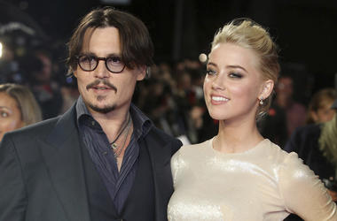 """In this Nov. 3, 2011 file photo, U.S. actors Johnny Depp, left, and Amber Heard arrive for the European premiere of their film, """"The Rum Diary,"""" in London. (AP Photo/Joel Ryan, File)"""