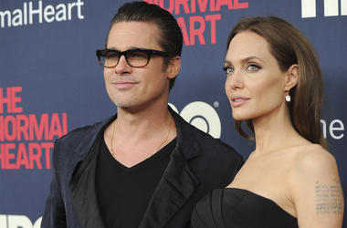 """In this May 12, 2014 file photo, Brad Pitt and Angelina Jolie attend the premiere of HBO Films' """"The Normal Heart"""" at the Ziegfeld Theatre in New York. (Photo by Evan Agostini/Invision/AP, File)"""