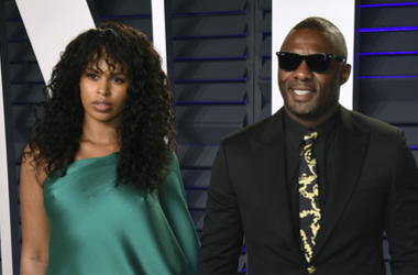 In this Sunday, Feb. 24, 2019 file photo, Idris Elba, right, and Sabrina Dhowre arrive at the Vanity Fair Oscar Party in Beverly Hills, California. (Photo by Evan Agostini/Invision/AP, File)