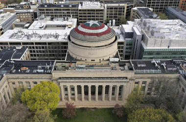This Sunday, April 28, 2019 photo provided by Raymond Huffman shows Massachusetts Institute of Technology's signature Great Dome draped with a giant cloth version of Captain America's red, white and blue shield, in Cambridge, Massachusetts. (Raymond Huffm
