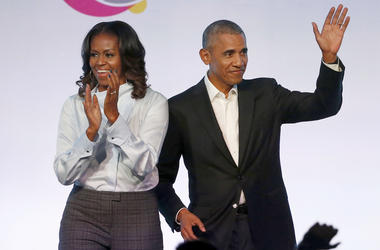 In this Oct. 31, 2017, file photo, former President Barack Obama, right, and former first lady Michelle Obama appear at the Obama Foundation Summit in Chicago. (AP Photo/Charles Rex Arbogast, File)