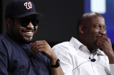 """In this July 29, 2008, file photo, Ice Cube, left, and director John Singleton, laugh during the ESPN panel for the documentary series """"30 for 30"""" at the Television Critics Association summer press tour in Pasadena, California. (AP Photo/Matt Sayles, File"""