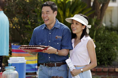 """In this image released by ABC, Randall Park, left, and Constance Wu appear in a scene from the new comedy series """"Fresh Off the Boat."""" (Nicole Wilder/ABC via AP)"""