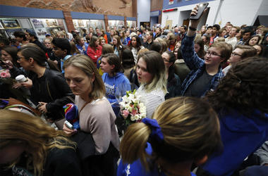 Students and other attendees walk out of a community vigil held to honor the victims and survivors of yesterday's fatal shooting at the STEM School Highlands Ranch, late Wednesday, May 8, 2019, in Highlands Ranch, Colo. (AP Photo/David Zalubowski)
