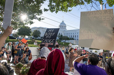 Lucia Hermo, with megaphone, leads chants during a rally against HB314, the near-total ban on abortion bill, outside of the Alabama State House in Montgomery, Ala., on Tuesday May 14, 2019. (Mickey Welsh/The Montgomery Advertiser via AP)