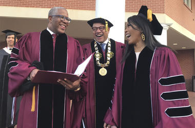 Robert F. Smith, left, laughs with David Thomas, center, and actress Angela Bassett at Morehouse College on Sunday, May 19, 2019, in Atlanta. (Bo Emerson/Atlanta Journal-Constitution via AP)