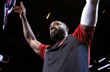 In this Wednesday, April 10, 2019, file photo, Miami Heat guard Dwyane Wade (3) acknowledges cheers from the crowd before the start of the final NBA basketball game of his career, against the Brooklyn Nets in New York. (AP Photo/Kathy Willens, File)