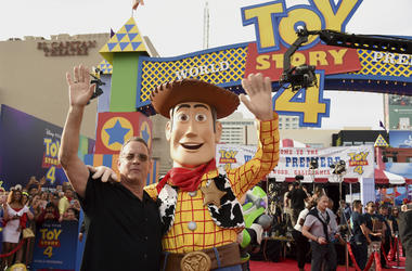 "Tom Hanks, left, poses with his character Woody as he arrives at the world premiere of ""Toy Story 4"" on Tuesday, June 11, 2019, at the El Capitan in Los Angeles. (Photo by Chris Pizzello/Invision/AP)"