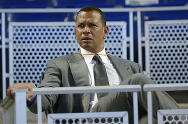 In this June 23, 2017, file photo, former baseball player Alex Rodriguez sits in the stands before the start of a baseball game in Miami. (AP Photo/Wilfredo Lee, File)