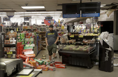 A worker steps over merchandise that is scattered on the floor of a Albertson's grocery store Saturday, July 6, 2019 following a earthquake in Ridgecrest, California. (AP Photo/Marcio Jose Sanchez)