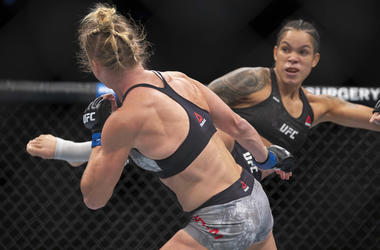 Amanda Nunes, right, knocks out Holly Holm with a kick during the first round of their women's bantamweight mixed martial arts title bout at UFC 239 on Saturday, July 6, 2019, in Las Vegas. Nunes won by knockout. (AP Photo/Eric Jamison)