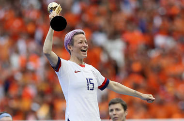 United States' Megan Rapinoe celebrates her team's victory with the trophy after the Women's World Cup final soccer match between US and The Netherlands at the Stade de Lyon in Decines, outside Lyon, France, Sunday, July 7, 2019. US won 2:0. (AP Photo/Dav