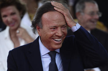In this Sept. 29, 2016 file photo, Spain's singer Julio Iglesias smiles during his star unveiling ceremony at the Walk of Fame in San Juan, Puerto Rico. (AP Photo/Carlos Giusti, File)