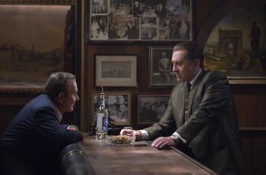 """This image released by Netflix shows Joe Pesci, left, and Robert De Niro in a scene from """"The Irishman."""" The film will make its world premiere at opening night of the New York Film Festival on September 27. (Niko Tavernise/Netflix via AP)"""