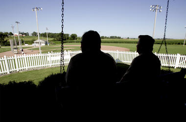 """In this July 11, 2007, file photo, New Mexico Gov. Bill Richardson, left, at the time a candidate for the Democratic presidential nomination, sits on the front porch of the house at the """"Field of Dreams"""" movie site during a campaign stop in Dyersville, Io"""