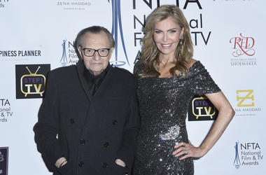In this Dec. 5, 2018 file photo Larry King, left, and Shawn King attend the 2018 National Film & Television Awards at the Globe Theatre in Los Angeles. (Photo by Richard Shotwell/Invision/AP)