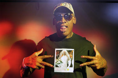 In this Monday, Sept. 9, 2019, photo, former NBA star Dennis Rodman poses wearing a T-shirt depicting himself in a wedding dress at a 1996 book promo event, in Los Angeles. (AP Photo/Damian Dovarganes)