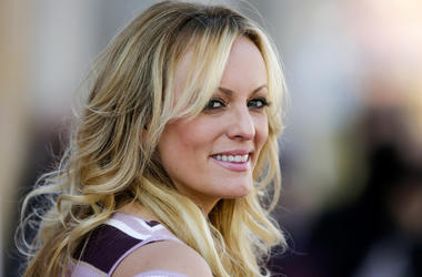 In this Oct. 11, 2018, file photo, adult film actress Stormy Daniels attends the opening of the adult entertainment fair 'Venus' in Berlin, Germany.