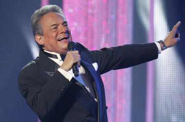 In this April 28, 2011 file photo, Jose Jose performs during the Latin Billboard Awards, in Coral Gables, Fla. Local media outlets report that the Mexican crooner died Saturday, Sept. 28, 2019 from pancreatic cancer. He was 71. (AP Photo/Carlo Allegri, Fi