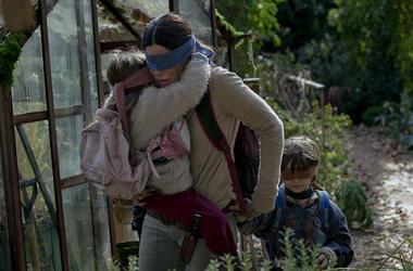 "Sandra Bullock, Julian Edwards and Vivien Lyra Blair in ""Bird Box"" (Photo credit: Netflix)"