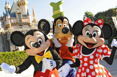 Standing in front of Sleeping Beauty Castle at Disneyland, where magical storybooks come alive, Mickey Mouse, Goofy and Minnie Mouse welcome visitors from all over the world. Combining classic favorites and exciting additions, Disneyland park is an essent