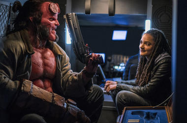David Harbour as 'Hellboy' and Sasha Lane as 'Alice Monoghan' in HELLBOY xxx-.jpg (Photo credit: Mark Rogers/Lionsgate)