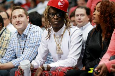 Rapper Young Thug during the second quarter of game two of the first round of the NBA Playoffs between Brooklyn Nets and Atlanta Hawks at Philips Arena.