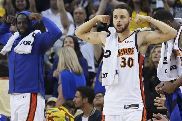 April 7, 2019; Oakland, CA, USA; Golden State Warriors forward Draymond Green (23) and guard Stephen Curry (30) celebrate on the bench during the fourth quarter against the LA Clippers at Oracle Arena. Mandatory Credit: Kyle Terada-USA TODAY Sports