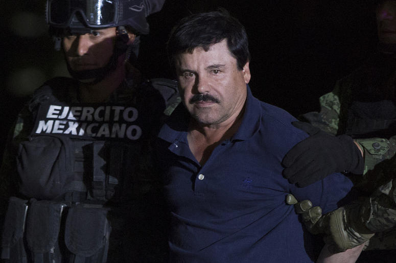 """(160109) -- MEXICO CITY, Jan. 9, 2016 (Xinhua) -- Soldiers escort Joaquin Guzman Loera, alias """"El Chapo"""", upon his arrival to the hangar of the Attorney General's Office, in Mexico City, capital of Mexico, on Jan. 8, 2016. After an early morning raid in n"""