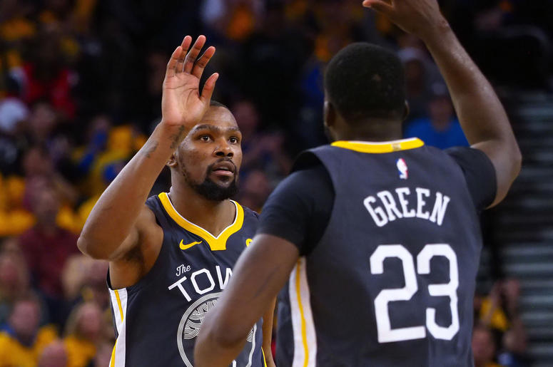 Apr 16, 2018; Oakland, CA, USA; Golden State Warriors forward Kevin Durant (35) high fives forward Draymond Green (23) after a basket against the San Antonio Spurs during the fourth quarter in game two of the first round of the 2018 NBA Playoffs at Oracle