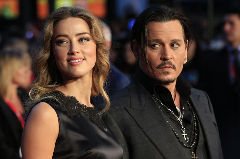 12/8/2017 - File photo dated 11/10/15 of Amber Heard and Johnny Depp. Amber Heard has spoken out after JK Rowling defended her decision to keep Johnny Depp in the Fantastic Beasts sequel. (Photo by PA Images/Sipa USA)