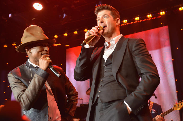 BEVERLY HILLS, CA - JANUARY 25: Recording artists Pharrell Williams and Robin Thicke perform onstage during the 56th annual GRAMMY Awards Pre-GRAMMY Gala and Salute to Industry Icons honoring Lucian Grainge at The Beverly Hilton on January 25, 2014 in Bev