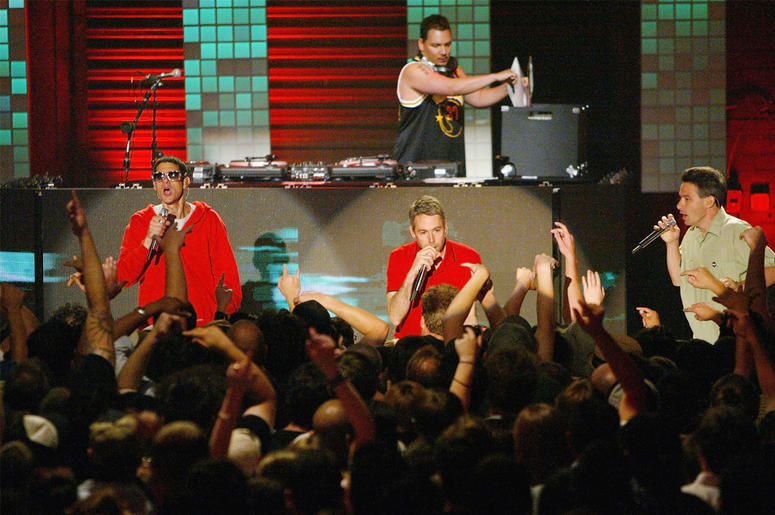 LAS VEGAS, NV - JUNE 9: (L-R) Michael Diamond 'Mike D', Adam Yauch 'MCA', Adam Horovitz 'Ad-Rock' and DJ Mix Master Mike(behind) of the Beastie Boys perform during MTV2's 2$Bill concert series at the Huntridge Theater, June 9, 2004 in Las Vegas, Nevada. (