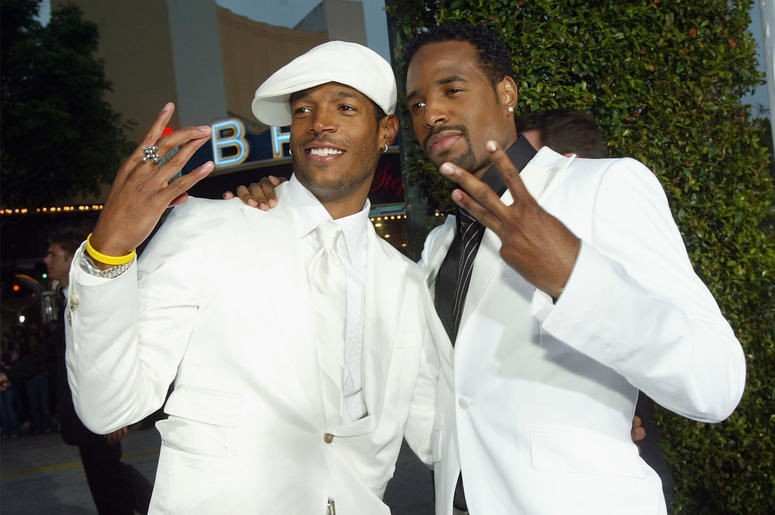 """LOS ANGELES - JUNE 16: Actors Marlon Wayans (L) and Shawn Wayans (R) arrive at the premiere of Revolution Studio's and Columbia Picture's """"White Chicks"""" at the Village Theatre on June 16, 2004 in Los Angeles, California. (Photo by Kevin Winter/Getty Image"""